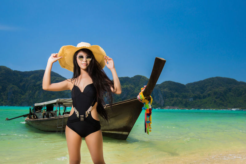 Beautiful Woman Beauty Beauty In Nature Clothing Day Fashion Front View Hat Land Leisure Activity Lifestyles Mountain Nature One Person Outdoors Scenics - Nature Sea Sky Sun Hat Three Quarter Length Water Young Adult Young Women
