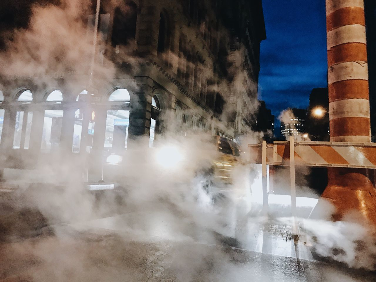 architecture, built structure, building exterior, smoke - physical structure, night, outdoors, city, illuminated, steam, no people, sky