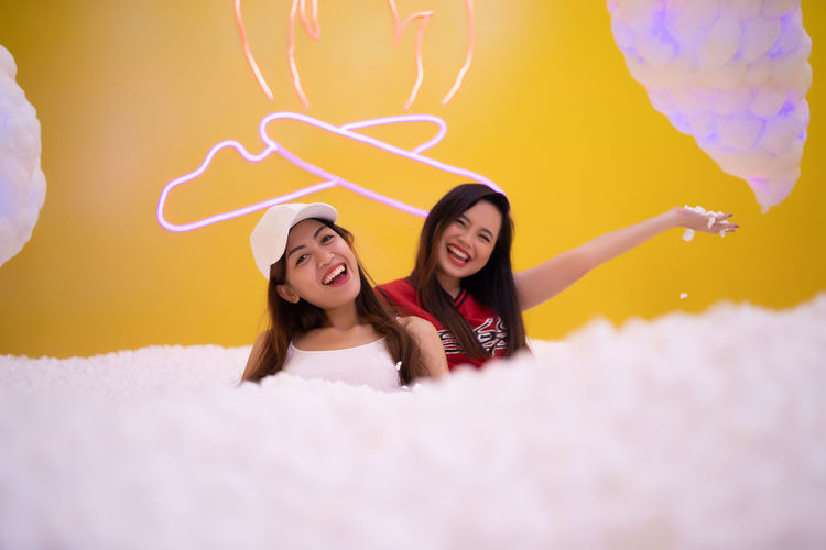 beautiful asian playing at styrofoam pool Happiness Smiling Women Emotion Two People Young Women Cheerful Young Adult Positive Emotion Togetherness Casual Clothing Fun Adult Front View Portrait Love Enjoyment Long Hair Headshot Human Arm Excitement Hairstyle