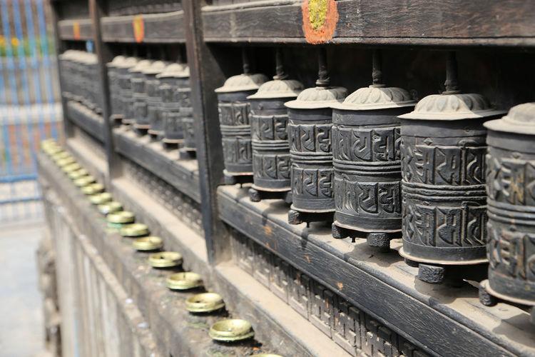 Prayer wheels at buddhist temple