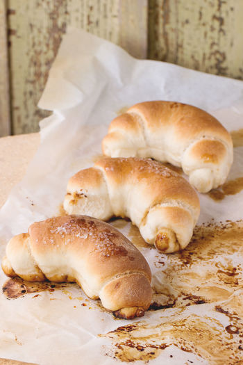 Fresh homemade baked crescent rolls on baking paper and oven stone over Baked Bakery Baking Paper Bread Bread Rolls Crescent Day Food Fresh Baked Bread Healthy Eating Homemade Bread Homemade Food Ready-to-eat Rolls Stone Sugar Table Tablecloth White