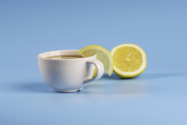 Close-up of drink on table against blue background