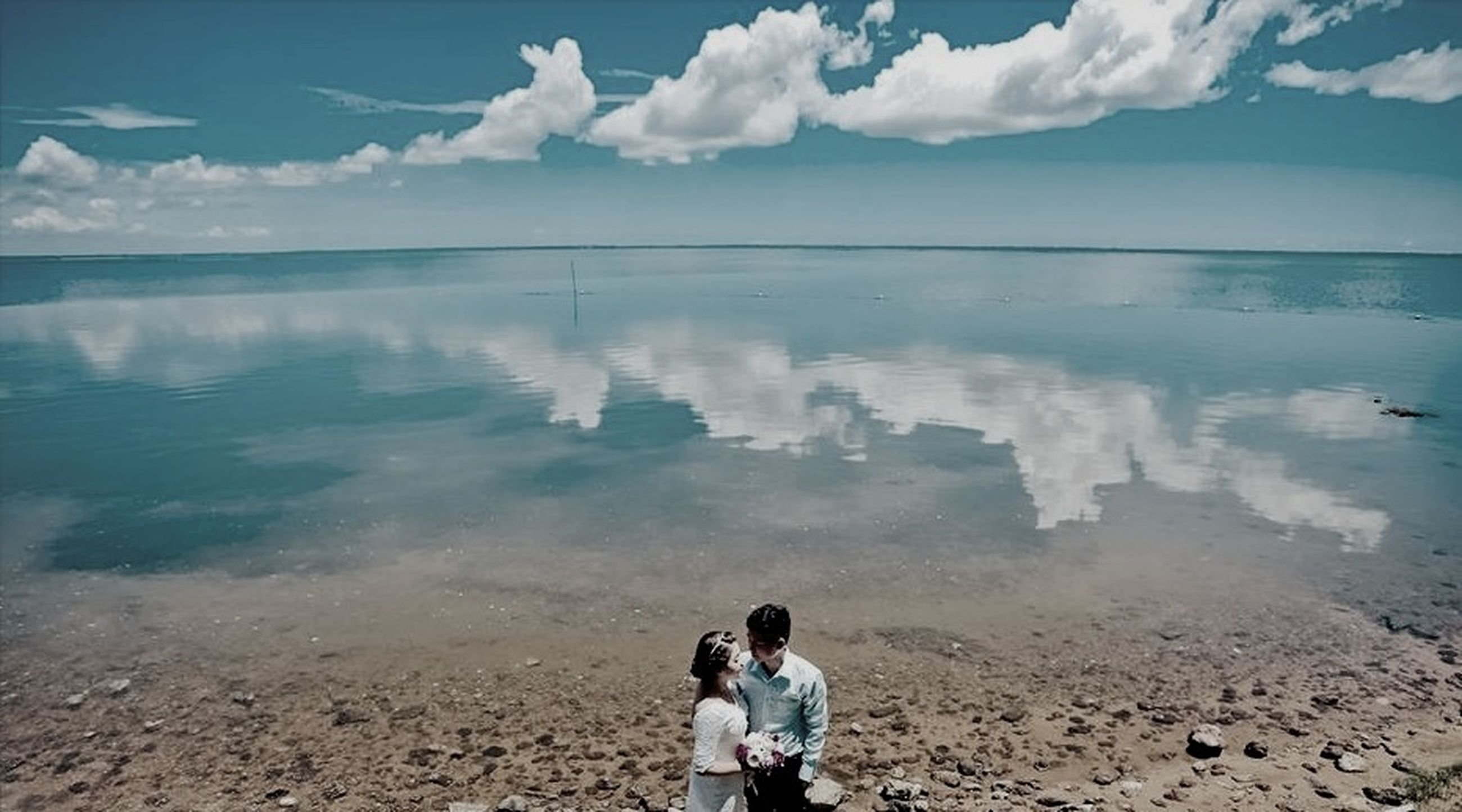 water, lifestyles, leisure activity, sea, sky, beach, shore, rear view, tranquility, men, standing, tranquil scene, scenics, horizon over water, nature, casual clothing, beauty in nature, vacations