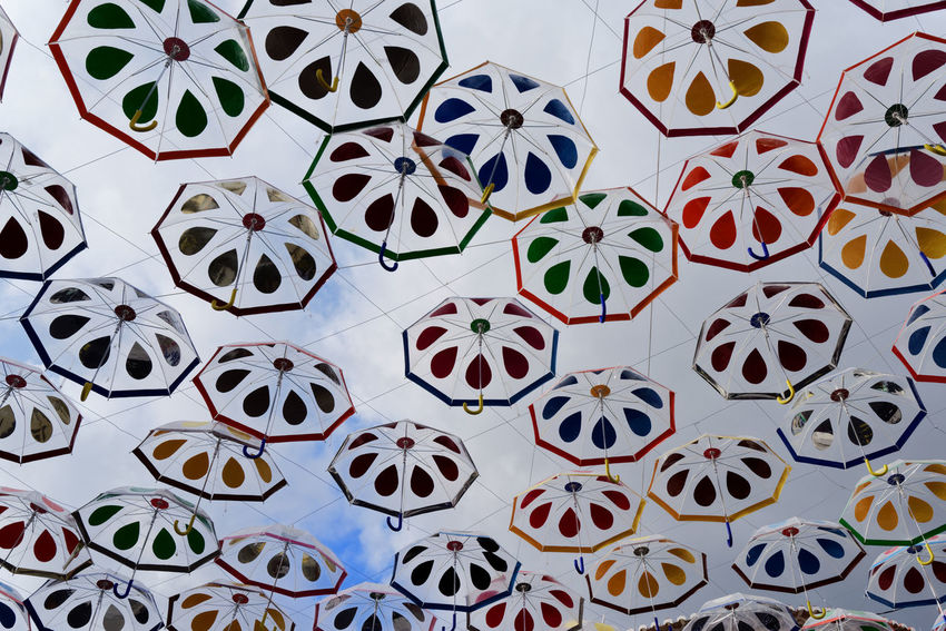Umbrellas against cloudy sky Madeira Art And Craft Backgrounds Clody Sky Clouds Creativity Design Full Frame High Angle View Indoors  Large Group Of Objects Multi Colored No People Parasol Pattern Repetition Shape Still Life Street Street Art Umbrella Variation My Best Travel Photo