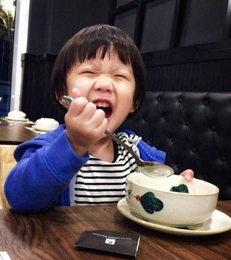 Gesture One Person Real People Front View Child Childhood Casual Clothing My Best Photo Lifestyles Food And Drink Portrait Leisure Activity Mouth Open Food Headshot Mouth Eating Utensil Table Innocence