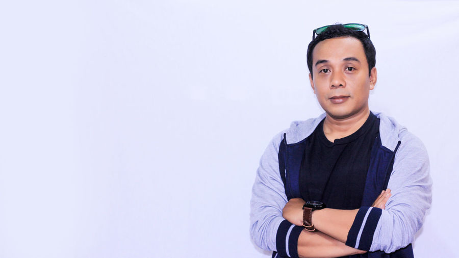 Portrait young asian man crossed his arm with copyspace Portrait Business Finance And Industry Studio Shot Mid Adult Arts Culture And Entertainment Fashion Confidence  Arms Crossed Smart Watch Posing Checking The Time