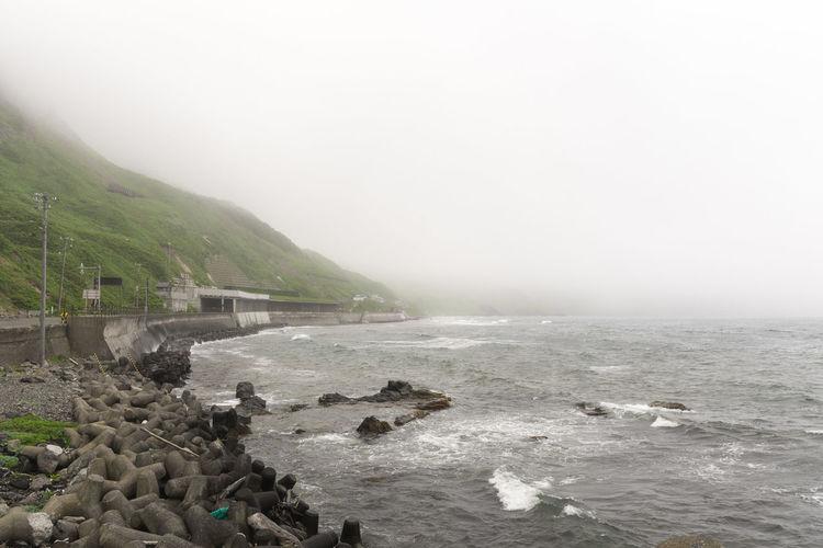 Fog Nature No People Water Outdoors Scenics Beauty In Nature Tranquility Landscape Day Beach Mountain Sky Breakwater Tetrapods Rebun Island Hokkaido Japan