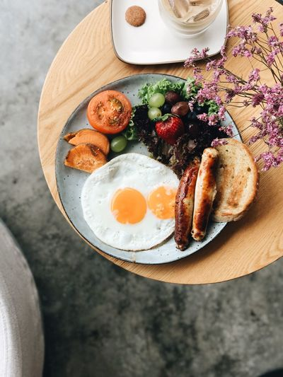Breakfast Food Food And Drink Freshness Table Ready-to-eat Healthy Eating Plate High Angle View Still Life Meal Directly Above Serving Size No People Egg Fried Wellbeing Fried Egg Breakfast Fruit Indulgence