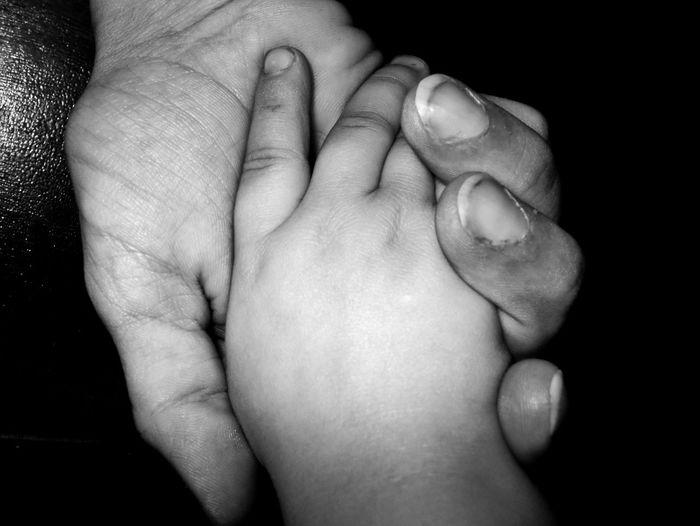 No bond like a mother's bond to her child Human Body Part Human Skin Child Adult Black Background Close-up Childhood Human Hand Blackandwhite