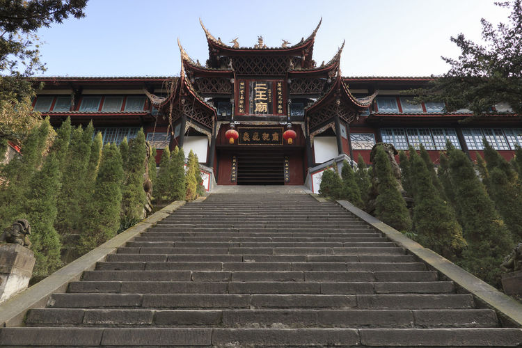 Dujiangyan, China - December 12, 2018: Buddhist temple in the Dujiangyan water reservoir area close to Chengdu Chengdu China ASIA Dujiangyan Temple Shrine Religion Architecture Built Structure Building Exterior Staircase Tree Plant Building The Way Forward Railing Steps And Staircases