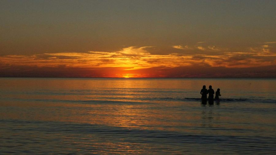 #sunset #balticsea #people #water #clouds Water Sea Sunset Beach Child Nautical Vessel Togetherness Friendship Silhouette Swimming