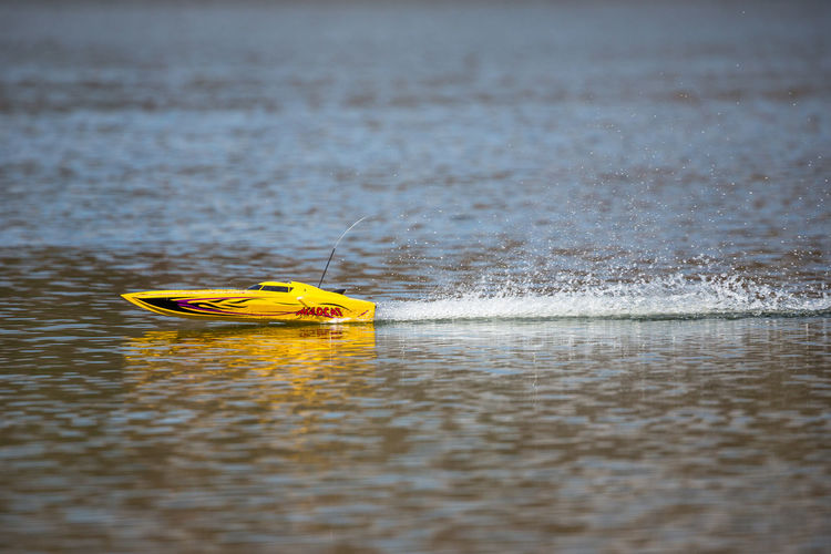 Yellow Toy Boat Sailing In Lake