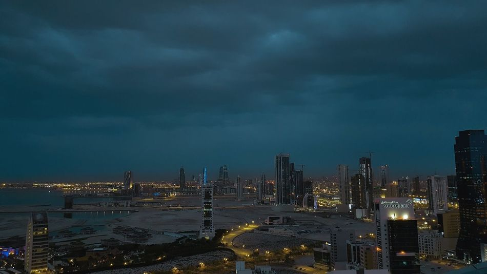 when it rains in the dessert City Cityscape Urban Skyline Modern Skyscraper Illuminated Downtown District Water Business Finance And Industry City Life Storm Cloud Office Building Forked Lightning Tornado Dramatic Sky Tall - High Tower Storm Sky Only Atmospheric Mood Settlement Horizon Over Water