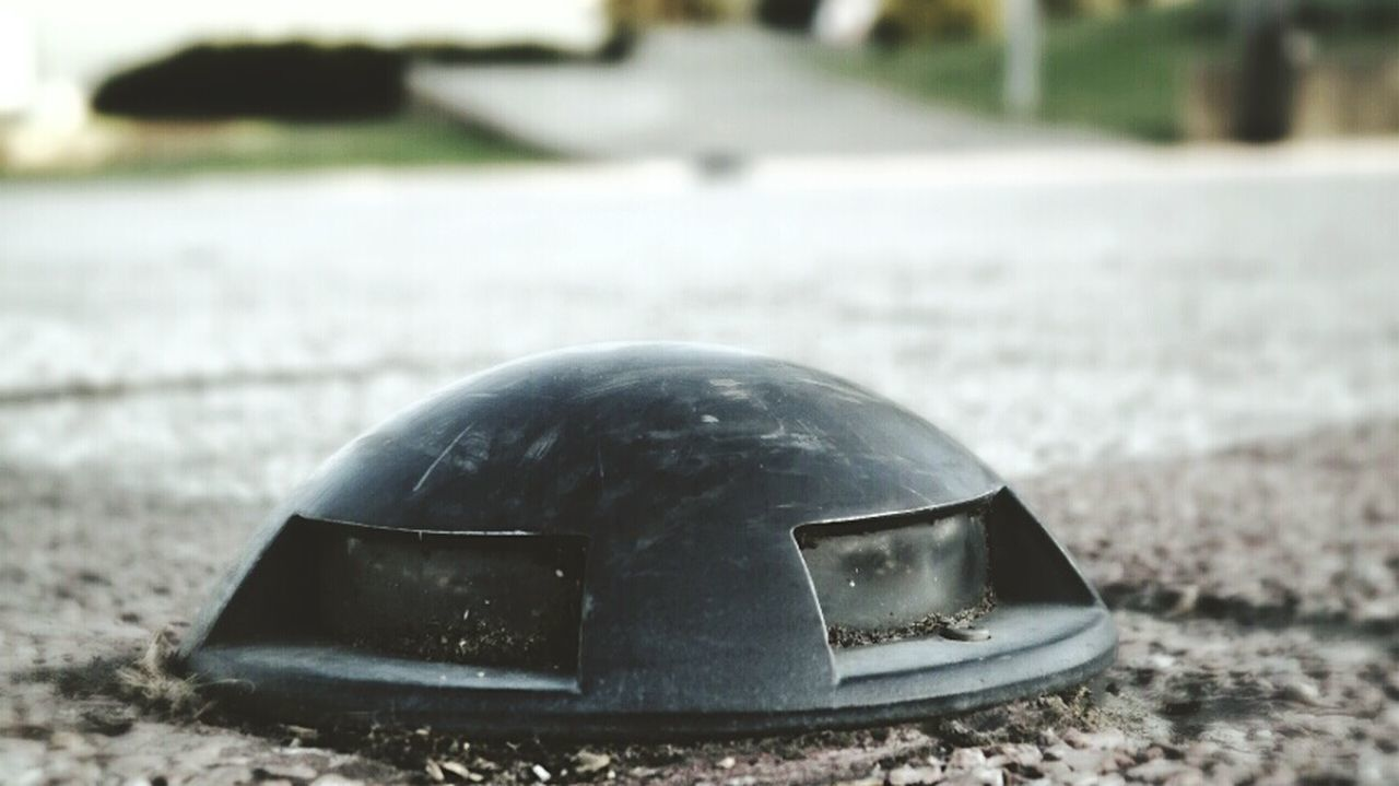 Close-Up Of Road Reflector On Street