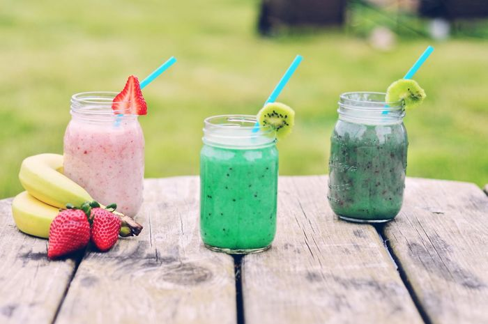 Refreshing fruit smoothies Milkshake Wood - Material Food And Drink Fruit Drink Green Color No People Drinking Glass Healthy Eating Table Refreshment Freshness Banana Refreshment Smoothie Day Outdoors Grass Food Ready-to-eat Organic Detox Summer Fruit Smoothie Kiwi