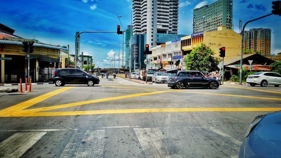 Car Land Vehicle Building Exterior Mode Of Transport Transportation Street City Traffic City Life On The Move Road Outdoors Vehicle Moving Development City Street Check This Out Blue Sky