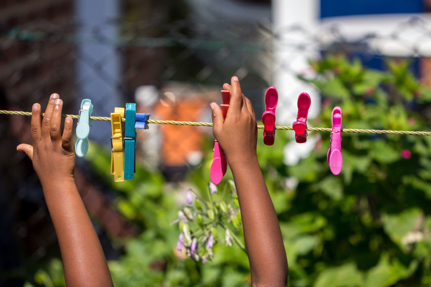African African American Children City Clothes Pegs Colourful Afro Caribbean Black British Child Childhood Close-up Colorful Focus On Foreground Garden Human Body Part Human Hand Kid Laundry Pegs Lifestyles Outdoors People Person Of Color Playing Washing Line Young Person The Week On EyeEm Fresh On Market 2017