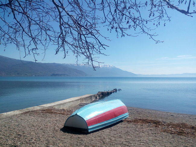 S e r e n i t y. Blue Water Nature No People Beauty In Nature Tranquility Lake Outdoors Tree Beach Nature Lake View Beauty In Nature Tranquil Scene Ohrid Lake Relaxing Simplicity Magic Boat Escape Blue Sky