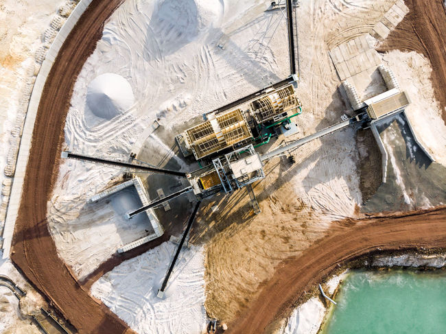 Aerial view of the processing plant with the sand fractionator at the edge of a quartz sand quarry pond for white quartz sand, made with drone Barge Drone  Drone Landscape Industry Quartz Suction Transport Aerial Aerial View Blue Crane - Construction Machinery Dredge Engeneering Excavation Germany Lake Mining Photo From Above Pit Quarry Sand Sediment Slush Soil Water