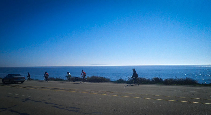Bicyclelife Bicycleride Bicycling Blue Sky California Coast Happy People Road Shoreline Waving Goodbye Waving Hello