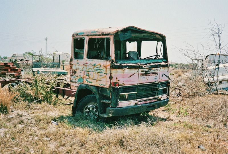 Truck Greece Santorini Graveyard Transportation Land Vehicle Damaged Old Field Outdoors Sun Travel Film Analogue Photography Photo Filmisnotdead Mode Of Transport Abandoned Nautical Vessel Obsolete Stationary Run-down Clear Sky Semi-truck Deterioration Day Trawler No People Weathered