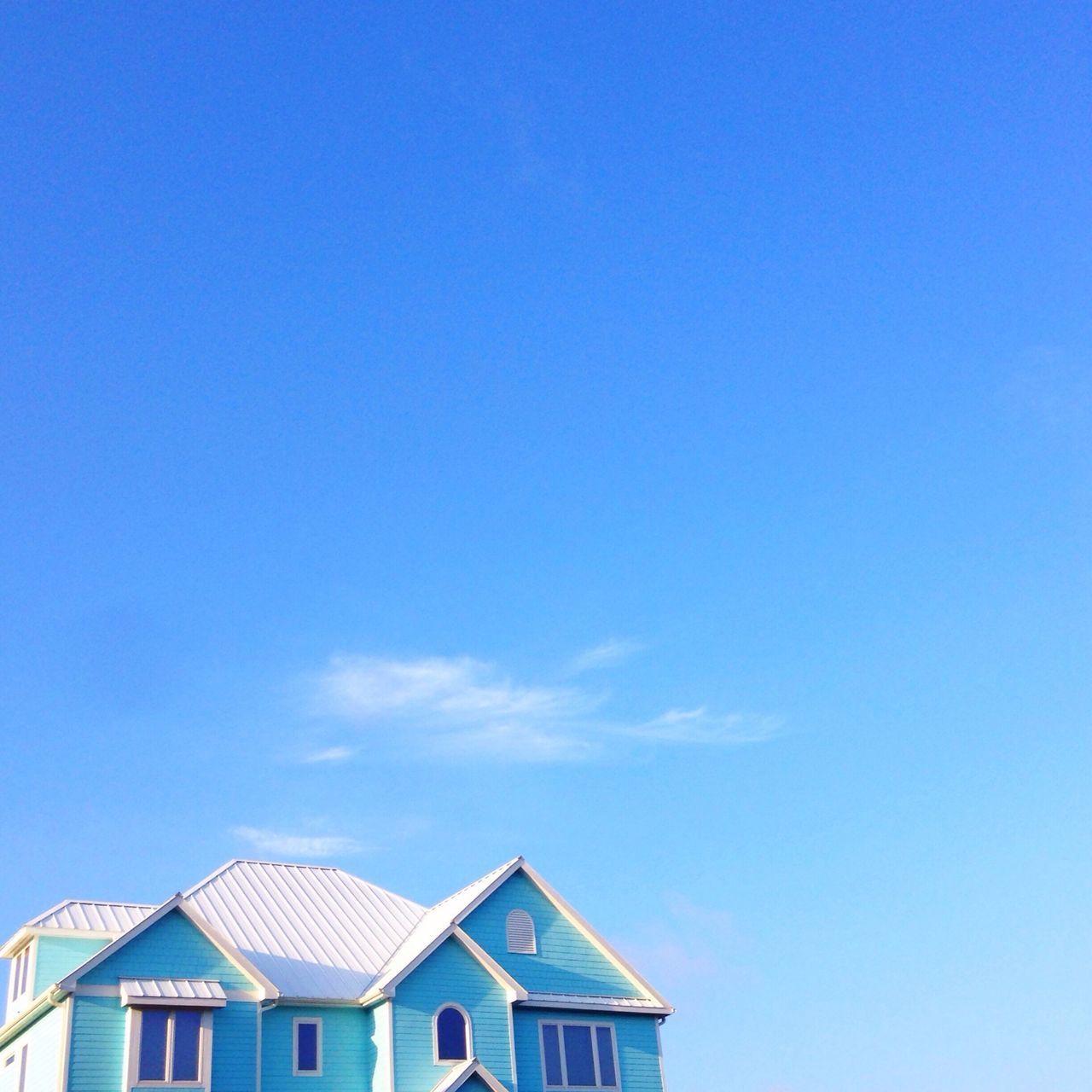 Blue house against blue sky