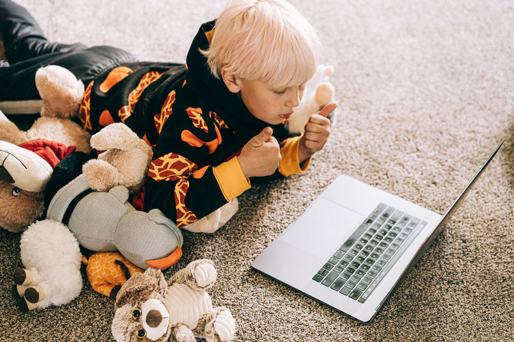High angle view of cute boy sitting at toy
