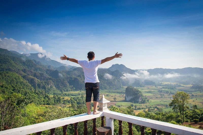 Human Arm Limb Mountain Sky Arms Outstretched Leisure Activity Standing Scenics - Nature One Person Nature Real People Beauty In Nature Lifestyles Rear View Casual Clothing Environment Day Tree Arms Raised Summer Road Tripping