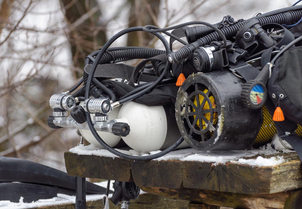CLOSE-UP OF MACHINE PART ON SNOW