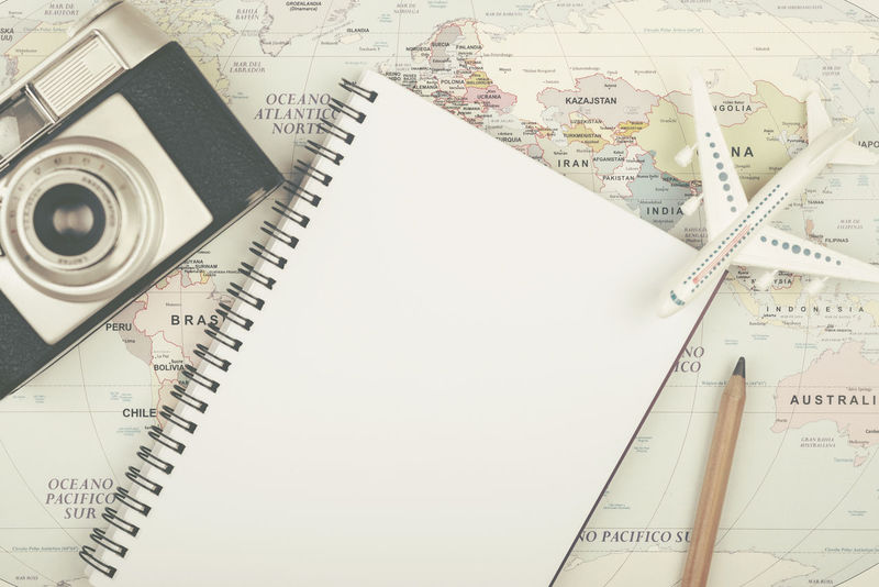 Earth Holidays Map Photos Plane Adventure Cartography Close-up Destination Diary Indoors  Location Map No People Note Pad Paper Photo Camera Roadmap Ruler Summer Tourism Traveler