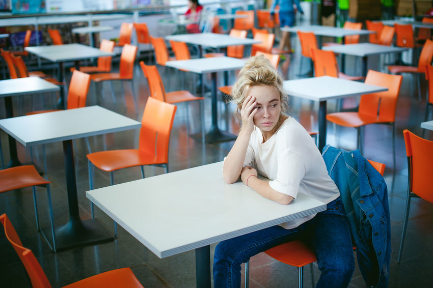 young beautiful woman in jeans clothes in business space of shopping center. portrait stylish girl in an empty cafe Blond Hair Cafe Chair Classroom Day Desk Education Focus On Foreground Indoors  Lecture Hall One Person People Real People Relaxation Restaurant Seat Sitting Smiling Student Table Young Adult The Graphic City EyeEmNewHere Love Yourself