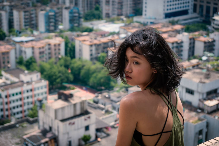 Portrait of beautiful young woman in city