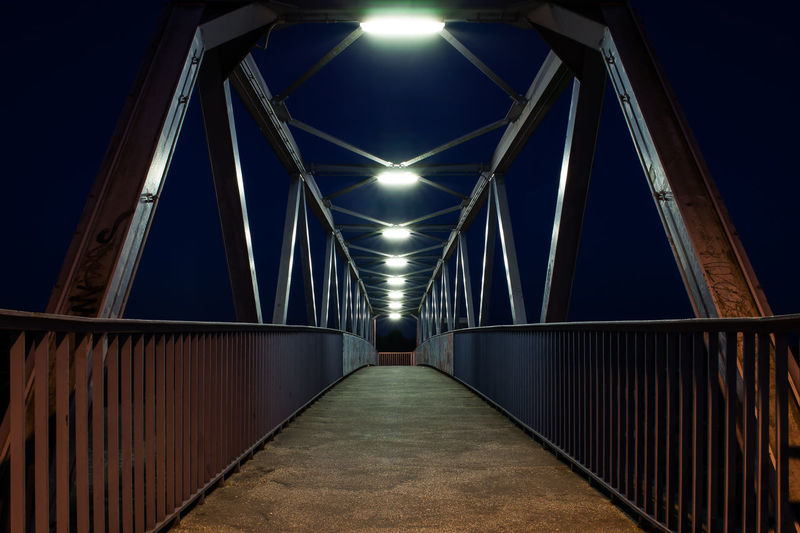 This pedestrian bridge enables people to bypass the railway. Captured in the night @ Brandenburg an der Havel, 2017-08-07 EyeEm Best Shots Reflection Reflections And Shadows Pedestrian Bridge EyeEmNewHere Footbridge Longtime Exposure NightTimePhotography Nightphotography Nighttime Architecture Bridge - Man Made Structure Built Structure Connection Illuminated Lighting Equipment Longtimeexposure Night Nighttime Lights No People Outdoors Pedestrian Overpass Sky Skywalk Skyway Suspension Bridge The Way Forward Transportation