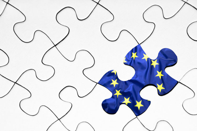 Jigsaw Piece Puzzle  Connection No People Indoors  Shape Jigsaw Puzzle Pattern Blue Design Full Frame White Color Close-up Backgrounds Solution Studio Shot Incomplete High Angle View Red Communication Europe European Union