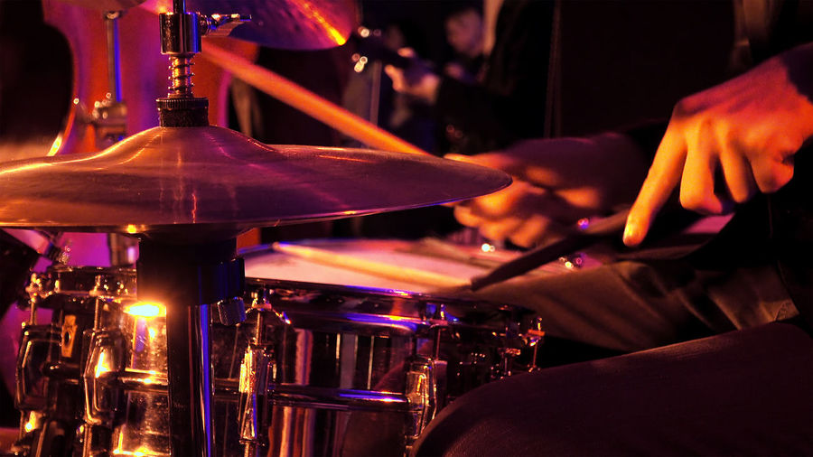 Cropped Image Of Man Playing Drum During Music Concert