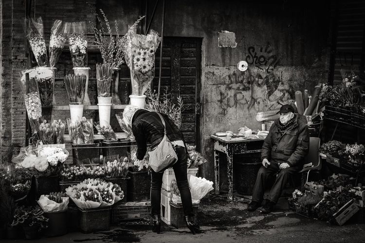 Urban Stall Flowers Street Woman Market Flowers Real People For Sale Indoors  Store Retail  Choice Full Length Men One Person Night People