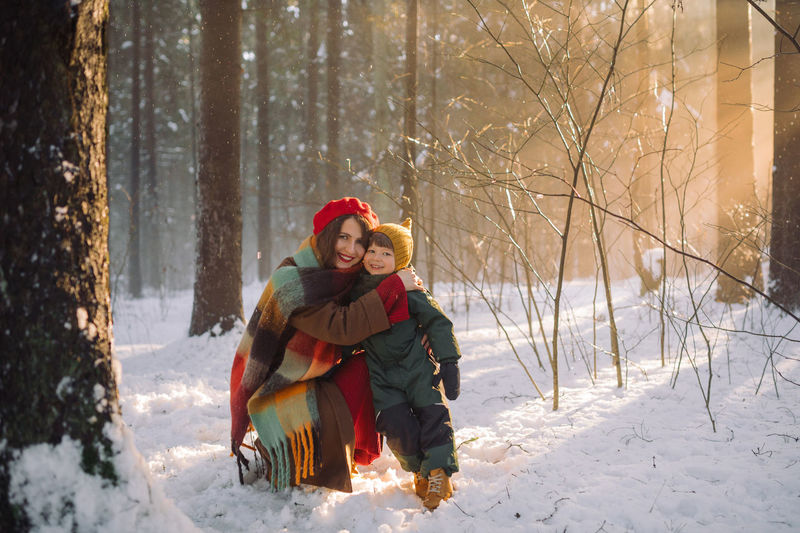 Young woman in forest during winter