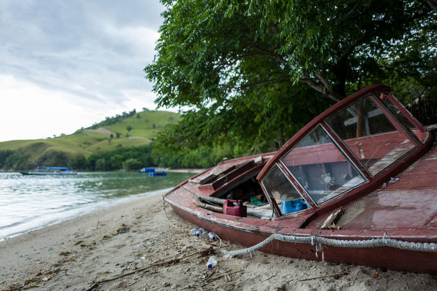 Labuan Bajo broken boat Abandoned Beach Car Day Lake Land Mode Of Transportation Motor Vehicle Nature Nautical Vessel No People Outdoors Plant Sky Tranquility Transportation Travel Tree Water