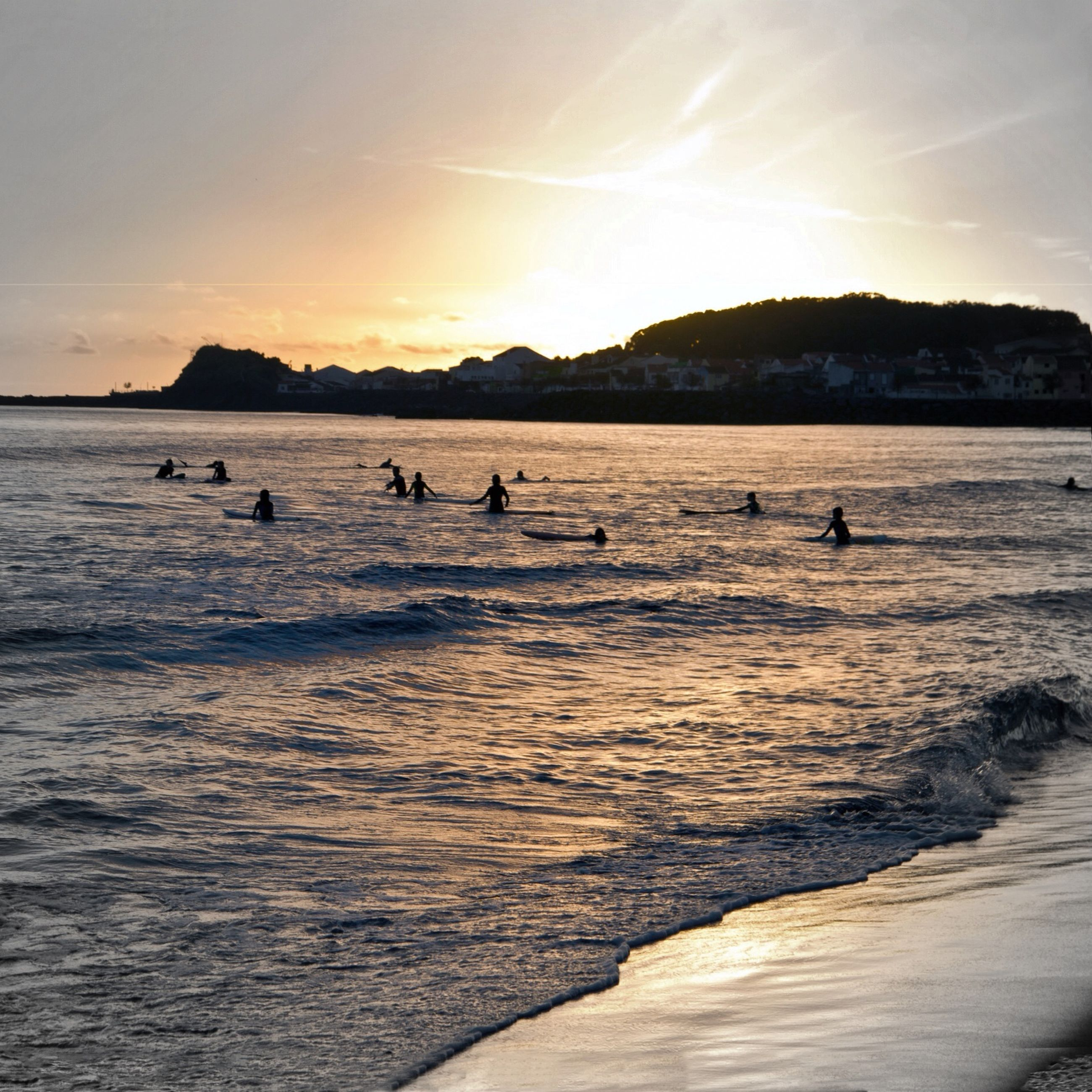 water, sea, beach, scenics, sky, beauty in nature, mountain, tranquil scene, sunset, tranquility, shore, nature, sand, animal themes, incidental people, sunlight, idyllic, sun, vacations