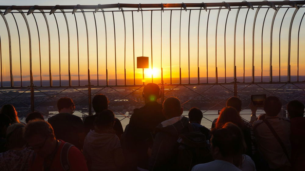 Empire State Building Tourists Beach Beauty In Nature Day Horizon Over Water Large Group Of People Men Nature Nautical Vessel Orange Color Outdoors People Real People Scenics Sea Silhouette Sky Sun Sunlight Sunset Travel Destinations Vacations Viewing Deck Water