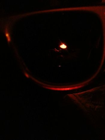Candle Light Through The Glass