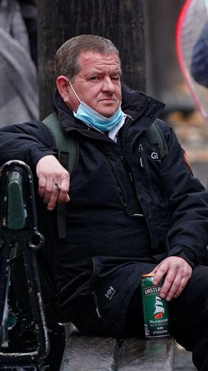 Full length of man sitting in snow