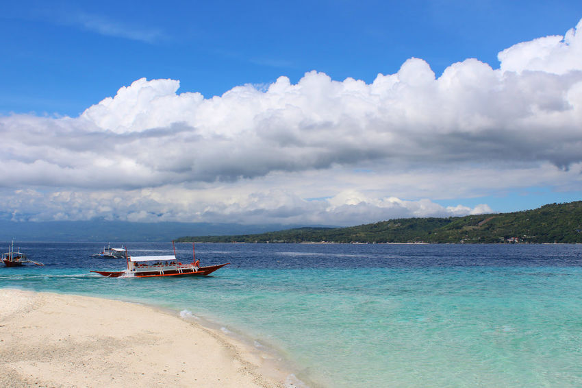 Sea Beach Sunny Cloud - Sky Blue Sky Sand Landscape Water Tourism Horizon Over Water Nature Sun Travel Destinations Vacations Summer Outdoors Beauty In Nature