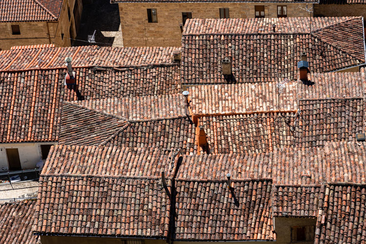 Background of old village houses with stone walls and red tile roofs. frias, burgos
