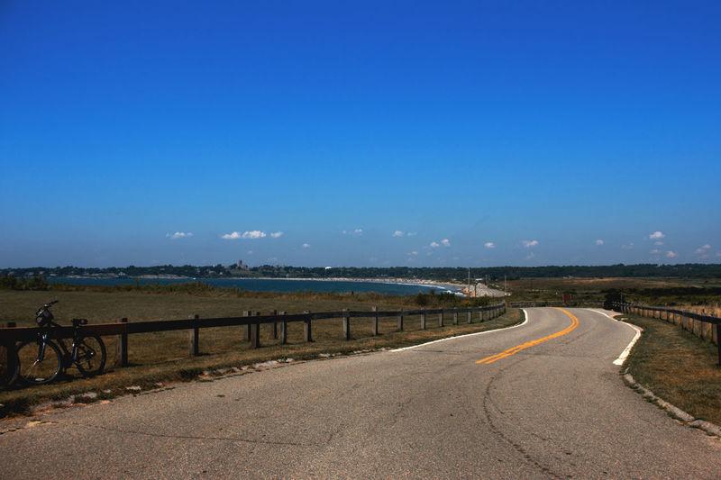 Empty road along sea