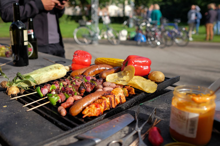 Close-Up Of Food On Barbeque Grill Against Road