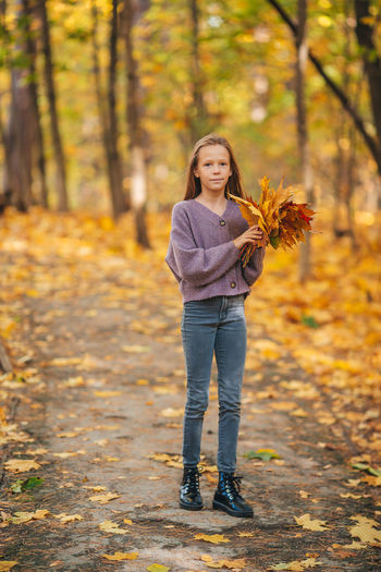 Portrait of a girl in autumn