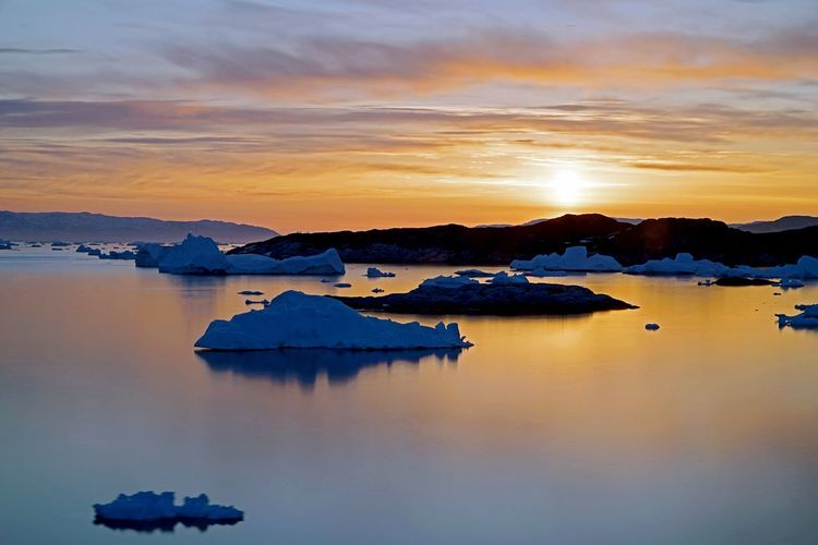 Iceberg Greenland Winter Snow Ice Iceberg İn Arctic Ocean Sunset Sky Water Reflection Scenics Beauty In Nature No People Cloud - Sky Iceberg Nature Tranquil Scene Shades Of Winter