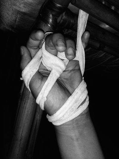Close-up of man holding rope