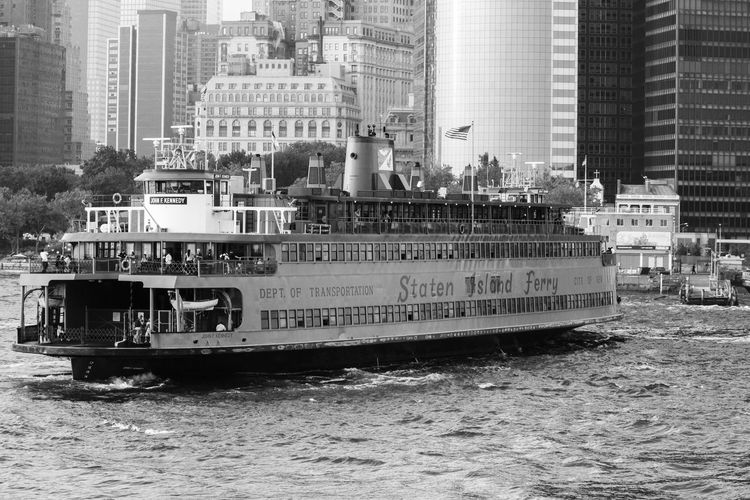 New York Nautical Vessel Mode Of Transportation Transportation Building Exterior Built Structure Architecture City Water Waterfront Day Building Motion No People Ship Sailing Nature Passenger Craft Craft Outdoors Office Building Exterior Skyscraper Cruise Ship